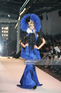 PARIS - JULY 3: A model presents a creation by Christian Lacroix during Paris Haute Couture Fashion Week for Fall/Winter 2007 - 2008 in Paris, France on July3, 2007 at the Palais de Toyko. (Photo by Michelle Leung/Wireimage)