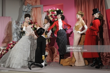 Designer John Galliano poses with his models at the Christian Dior Haute Couture show as part of the Paris Fashion Week Spring/Summer 2010. (Photo by Stephane Cardinale/Corbis via Getty Images)